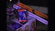 1974: a look at the many presents and toys from a past family christmas Stock Footage