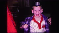 1974: happy boy wearing a funny hat in his pajamas LYNBROOK, NEW YORK Stock Footage