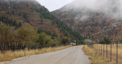 Rural mountain road pickup truck toward autumn storm fast DCI 4K Stock Footage