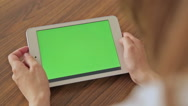 Pretty woman holding in hand tablet with green screen display Stock Footage