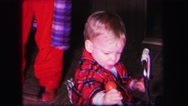 1974: child playing with his toys next to another person LYNBROOK, NEW YORK Stock Footage