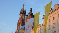 Krakow WYD 2016 - WYD's flag floating in wind on main square - sunny summer Stock Footage
