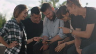 Group of Teenagers Using Mobile Phone for Entertainment Outdoors Stock Footage