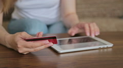 Woman's hands typing security code from credit card Stock Footage