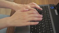 Hands typing on a laptop keyboard Stock Footage