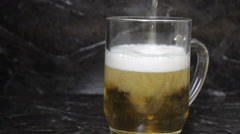 Pouring mug of beer Stock Footage