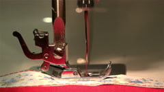 Sewing machine stitching on the fabric performs threading her needle and thread Stock Footage