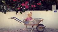 Little girl in a wheelbarrow Stock Footage
