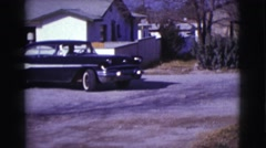 1961: one person in an old black car with white stripe backing up and pulling Stock Footage