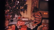 1961: boys are opening their christmas presents CLARKSDALE, ARIZONA Stock Footage