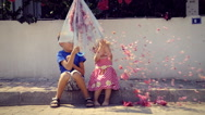 Kids with umbrella and flowers Stock Footage