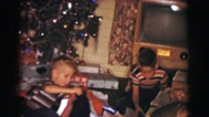 1961: children opening up presents and showing them proudly CLARKSDALE, ARIZONA Stock Footage