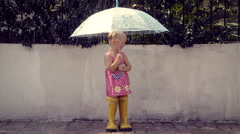 Little girl under the rain Stock Footage