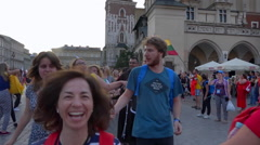 Joyful people dancing on public square during festival - Krakow WYD 2016 Stock Footage