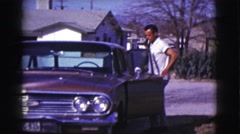 1961: how to get in the car when people are watching you CLARKSDALE, ARIZONA Stock Footage