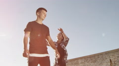 Happy Teenager Man Carrying Girlfriend Piggyback at Bright Summer Day. Stock Footage