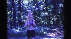 1961: a man carrying a boy on his shoulders CLARKSDALE, ARIZONA Stock Footage