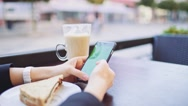 Businesswoman Hands using Smartphone in outdoor Cafe, Close Up SLOW MOTION. Stock Footage