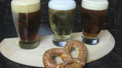 Flight of beer with pretzel Stock Footage
