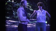 1961: a shirtless man and a woman share a laugh in a forest. CLARKSDALE, ARIZONA Stock Footage