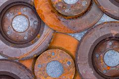 Layer of overlapping old rusty brake rotors Stock Photos
