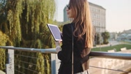 Young Businesswoman Using Digital Tablet in Sunny City. SLOW MOTION STEADICAM Stock Footage