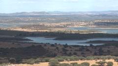 Lake from alqueva dam and cork oak forest field Alentejo Portugal Stock Footage