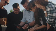 Group of Teenagers Using Tablet Computer for Entertainment Outdoors Stock Footage