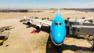 Stationary Time-lapse Airplane Parked Gate Runway Thirds Through Terminal Glass Stock Footage
