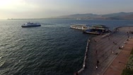 Izmir city center with coastline and ferries. Turkish city, drone shot Stock Footage