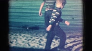 1961: vacation to the beach and exploring the sand. CLARKSDALE, ARIZONA Stock Footage