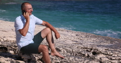 Relaxed Mature Man Talking Cellphone Traveler Phone Call Seaside Tropical Water Stock Footage