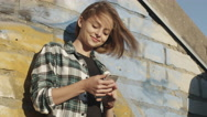 Attractive Teenager Girl Using Mobile Phone Outdoors in Urban Environment. Stock Footage