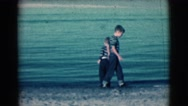 1961: boys with father by the sea CLARKSDALE, ARIZONA Stock Footage
