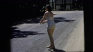 1962: barefoot woman throws ball dusty road sand sunny day 1950s-1960s  Stock Footage