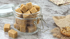 Cookies and a bowl of brown sugar on a rustic wooden table. Prores 4K Stock Footage