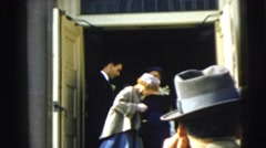 1962: at a church, a wedding party exits the building and waits for the bride Stock Footage