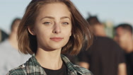 Portrait of Attractive Young Girl Looking at Camera and Smiling Outdoo Stock Footage