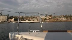 Empty bow chair on a catamaran moving through harbor on a cloudy afternoon.mp Stock Footage