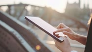 Businesswoman Hands Using Digital Tablet in Sunny City. SLOW MOTION. STEADICAM Stock Footage