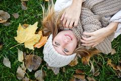 The girl lying on the fallen leaves. Autumn. Stock Photos