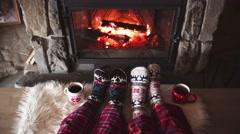 Feet in woollen socks by the Cozy Burning Christmas fireplace. 4K. Stock Footage