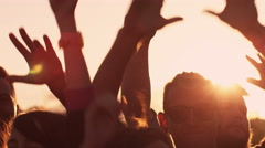 Group of People Dancing and Raising Hands Outdoors in Sunlight. Slow Motion Shot Arkistovideo