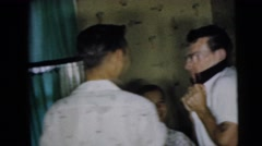 1962: several people enjoying themselves at a party CAMDEN, NEW JERSEY Stock Footage