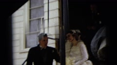 1962: bride steps down the entrance of a building  Stock Footage