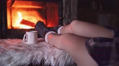 Feet in woollen socks by Burning Christmas Fireplace. 4K STABILIZED shot. Stock Footage