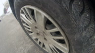Moving car. View of wheel, close-up Stock Footage