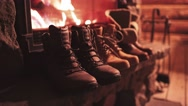 Winter Boots drying in front of a Cozy Burning Fireplace. 4K Stabilized shot. Stock Footage