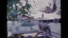 1964: a handsome, shirtless man stepping out from a recreational vehicle Stock Footage