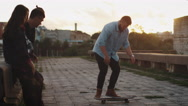 Skateboarder performing Tricks for his Teenager Friends. Stock Footage